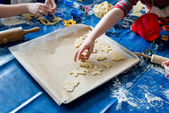 Children baking Christmas cookies — Stock Photo