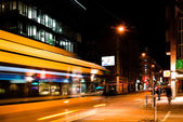 Night scenery at the crossroads - bus — Stock Photo
