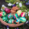 Easter basket amongst spring crocus flowers — Stock Photo