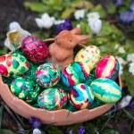 Easter basket amongst spring crocus flowers — Stock Photo
