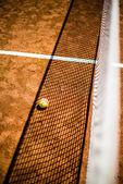 Tennis ball on court — Stock Photo
