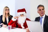 Santa Claus in business meeting — Stock Photo