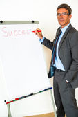 Businessman with Flipchart — Stock Photo