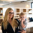 Businesswoman with small child in the office — Foto de Stock