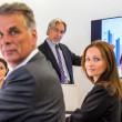 Стоковое фото: Mixed group in business meeting looking at you