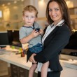 Stock Photo: Businesswomwith small child in office
