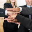 Teamwork - business people with joint hands in the office — Stock Photo #29927555