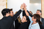Teamwork - business people with joint hands in the office — Stock Photo
