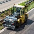 Road roller during asphalt paving works — Stock Photo