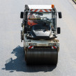 Road roller during asphalt paving works — Stock Photo #30004623