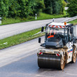 Road roller during asphalt paving works — Stock Photo #30005115