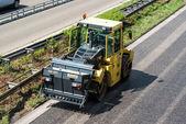 Road roller during asphalt paving works — Stock Photo