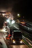 Road works, removal of old asphalt pavement at night — Stock Photo