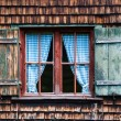Idyllic Bavarian alpine cottage window — Stock Photo