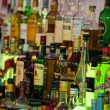 Alcoholic beverages in bottles at a bar. — Stock Photo #37951201