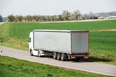 White truck moving on a main road — Stock Photo
