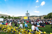 People enjoying open air cinema in the city center of Stuttgart (Germany) — Stock Photo