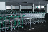Rows of shopping carts in abandoned car park — Stock Photo