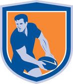 Hráč Rugby, předávání míče štít retro — Stock vektor