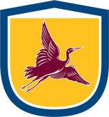 Heron Crane Flying Side View Shield Retro — Stock Vector
