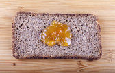 Jam on rye bread — Stock Photo