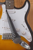 Guitar and microphone — Stock Photo