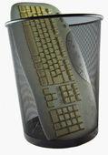 Keyboard in trash can — Stock Photo
