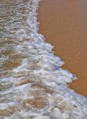 Sea coming to beach — Stock Photo