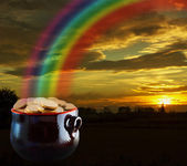 Gold at the end of rainbow — Stock Photo