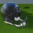 Football helmet over green field — Stock Photo #40399769