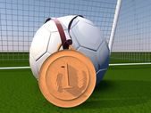 Football and gold medal — Stock Photo