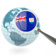 Stock Photo: Magnified flag of anguillwith blue globe