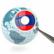 Stock Photo: Magnified flag of laos with blue globe