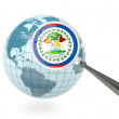 Stock Photo: Magnified flag of belize with blue globe