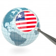 Stock Photo: Magnified flag of liberiwith blue globe