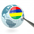 Magnified flag of mauritius with blue globe — Stock Photo