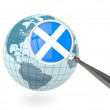 Magnified flag of scotland with blue globe — Stock Photo