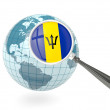 Magnified flag of barbados with blue globe — Stock Photo