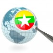 Magnified flag of myanmar with blue globe — Stock Photo #24307559