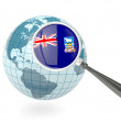 Magnified flag of falkland islands with blue globe - Stock Photo