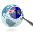 Stock Photo: Magnified flag of south georgiwith blue globe