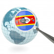 Stock Photo: Magnified flag of swaziland with blue globe
