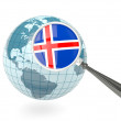 Magnified flag of iceland with blue globe — Stock Photo