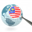 Stock Photo: Magnified flag of malaysiwith blue globe