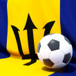 Flag of barbados with football in front of it — Stock Photo