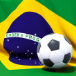 Flag of brazil with football in front of it — Stock Photo