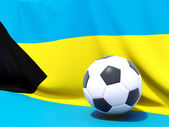 Flag of bahamas with football in front of it — Stok fotoğraf