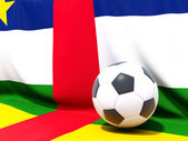 Flag of central african republic with football in front of it — Stok fotoğraf