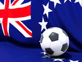 Flag of cook islands with football in front of it — ストック写真