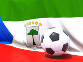 Flag of equatorial guinea with football in front of it — Stock Photo
